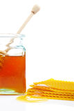 Honey jar and honeycomb Royalty Free Stock Photos