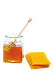 Honey jar and honeycomb Royalty Free Stock Images