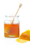 Honey jar and honeycomb Stock Photography