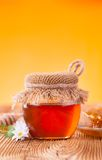 Honey in jar with honeycomb and wooden drizzler Stock Images