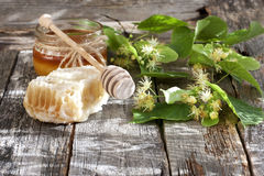 Honey in jar with honeycomb and wooden spoon Stock Photo