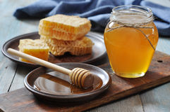 Honey in jar with honeycombs Royalty Free Stock Photography