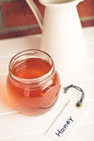 Honey in jar and label Royalty Free Stock Images