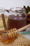 Honey in jar on a light background. Honey in  jar with honey dipper on a light background Royalty Free Stock Photo