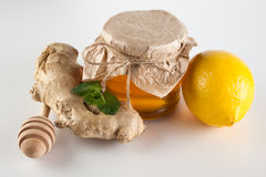 Honey in jar , mint,  lemon and ginger on a white background Stock Photography