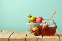 Honey jar and pomegranate on wooden table with copy space Stock Photography