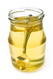 Honey in jar with silver spoon Royalty Free Stock Photography