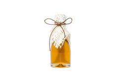 Honey jar, tied with a gold ribbon Stock Photos