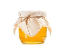 Honey jar on white Stock Image