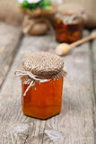 Honey in jar. On wooden background royalty free stock images