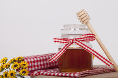 Honey in jar on a wooden background Royalty Free Stock Photography