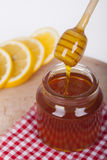 Honey in jar on a wooden background Stock Photos