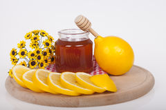 Honey in jar on a wooden background Stock Photo