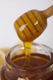 Honey in jar on a wooden background Royalty Free Stock Image