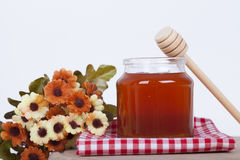 Honey in jar on a wooden background. Honey in  jar with honey dipper on a wooden background Stock Photography