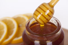 Honey in jar on a wooden background. Honey in  jar with honey dipper on a wooden background Stock Photo