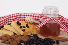 Honey in jar on a wooden background Royalty Free Stock Images
