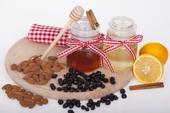 Honey in jar on a wooden background Stock Images