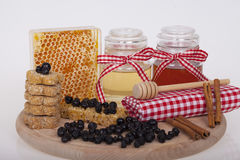 Honey in jar on a wooden background. Honey in  jar with honey dipper on a wooden background Royalty Free Stock Images