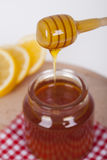 Honey in jar on a wooden background. Honey in  jar with honey dipper on a wooden background Stock Photos
