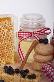 Honey in jar on a wooden background Stock Photography