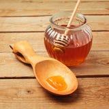 Honey jar on wooden background Royalty Free Stock Photo