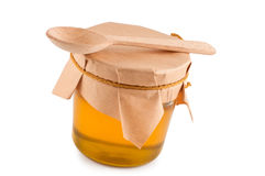 Honey in jar, wooden spoon. Royalty Free Stock Photos