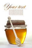Honey in jar Stock Images