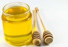 Honey jar and wooden stick.  Stock Photos