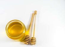 Honey jar and wooden stick.  Royalty Free Stock Images