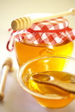 Honey in jar. With wooden sticks Royalty Free Stock Photo