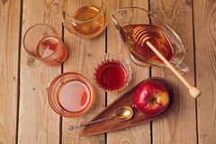 Honey jars and apple on wooden table. View from above Stock Image
