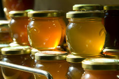 Honey jars on a shelf Stock Photography