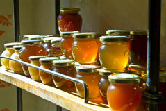 Honey jars on a shelf Stock Photos
