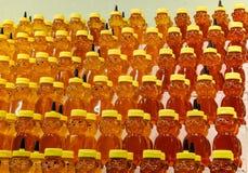 Honey jars on shelves Royalty Free Stock Image