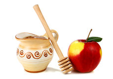 Honey in a jug and apple Royalty Free Stock Photo