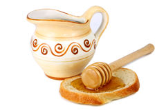 Honey in a jug and loaf Royalty Free Stock Images