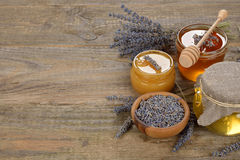 Honey with lavender. On a brown background royalty free stock photos