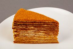 Honey layered cake. In the bowl stock images
