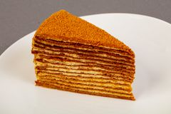 Honey layered cake. In the bowl royalty free stock photo