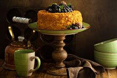 Honey layered cake with candy and berry royalty free stock photo