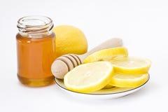 Honey and lemon Stock Images