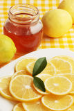 Honey and  lemon. Means people medicine/honey and the lemon Royalty Free Stock Image