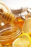 Honey and lemon. On table Stock Photos