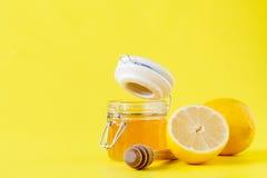 Honey Lemon. On bright yellow background Royalty Free Stock Images