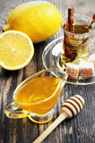 Honey, lemon and a cup of tea. On a wooden table Stock Images