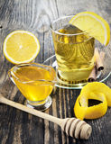 Honey, lemon and a cup of tea. On a wooden table Royalty Free Stock Photography