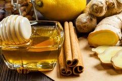 Honey, lemon, ginger and cinnamon - useful additives to tea and drinks stock photos