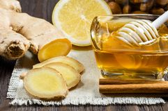 Honey, lemon and ginger - useful additives to tea and drinks royalty free stock photos