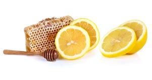 Honey and lemon isolated on white background. Stock Image